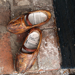 wooden shoes & newspaper inlay, by Kokjebalder, with Creative Commons licence